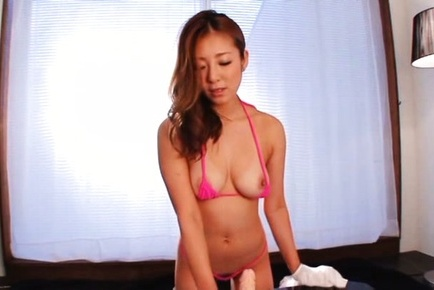Minori hatsune. Minori Hatsune Asian rubs her big knockers